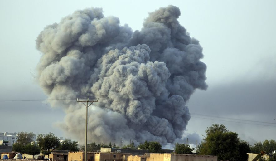 In this Monday, Oct. 13, 2014, file photo, thick smoke rises following an airstrike by the U.S.-led coalition in Kobani, Syria, as fighting continued between Syrian Kurds and the militants of Islamic State group, as seen from Mursitpinar on the outskirts of Suruc, Turkey. (AP Photo/Lefteris Pitarakis, File)