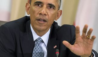 President Barack Obama speaks during a meeting with more than 20 foreign defense ministers on the ongoing operations against the Islamic State group, Tuesday, Oct. 14, 2014, at Andrews Air Force Base, Md. Obama and military chiefs in a show of strength against Islamic State fighters in Iraq and Syria.  (AP Photo/Evan Vucci)
