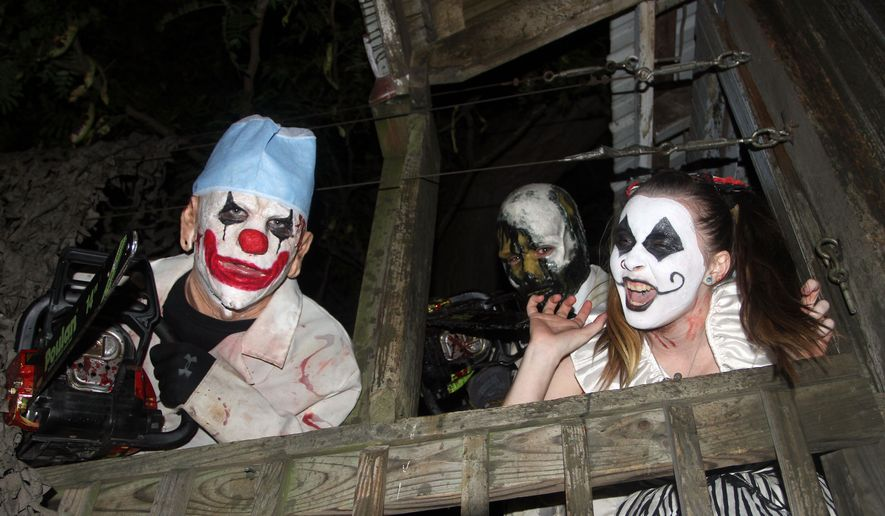 "Clowns are ready to greet guests at the ""Field of Screams"" in Mountville, Pennsylvania. (Photograph by Jacquie Kubin / Special to The Washington Times)"