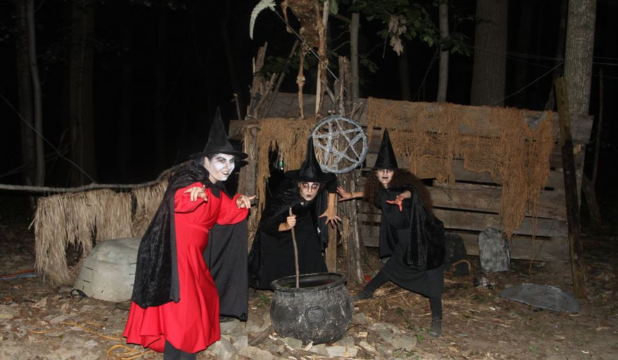 Witches cause trouble on the Trail of Terror at the 'Field of Screams' in Olney, Maryland. (Photograph by Jacquie Kubin / Special to The Washington Times)
