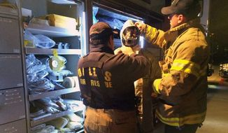 Members of Dallas Fire-Rescue Department prepare to decontaminate common areas near the Dallas apartment of a second health care worker who has tested positive for Ebola. (Associated Press) ** FILE **