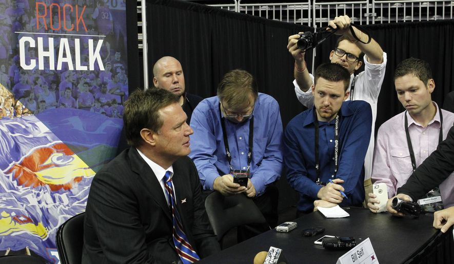 Kansas head coach Bill Self talks about his team's strengths in the upcoming NCAA men's college basketball season during a Big 12 Conference Media Day event at the Sprint Center in Kansas City, Mo., Wednesday, Oct. 15, 2014. (AP Photo/Colin E. Braley)