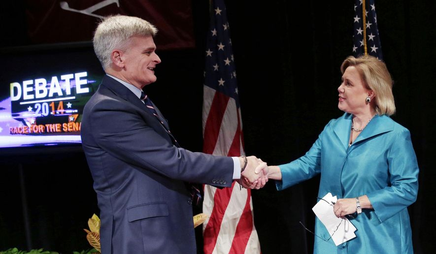 Sen. Mary Landrieu, right, D-La., greets Senate candidate, Rep. Bill Cassidy, R-La., before their debate at Centenary College in Shreveport, La., Tuesday, Oct. 14, 2014. (AP Photo/Gerald Herbert)