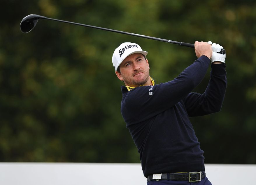 Northern Ireland's  Graeme McDowell plays a tee shot  during day one of the World Match Play Championship at The London Club, in Ash southeast England Wednesday Oct. 15, 2014. (AP Photo/Nigel French/PA) UNITED KINGDOM OUT