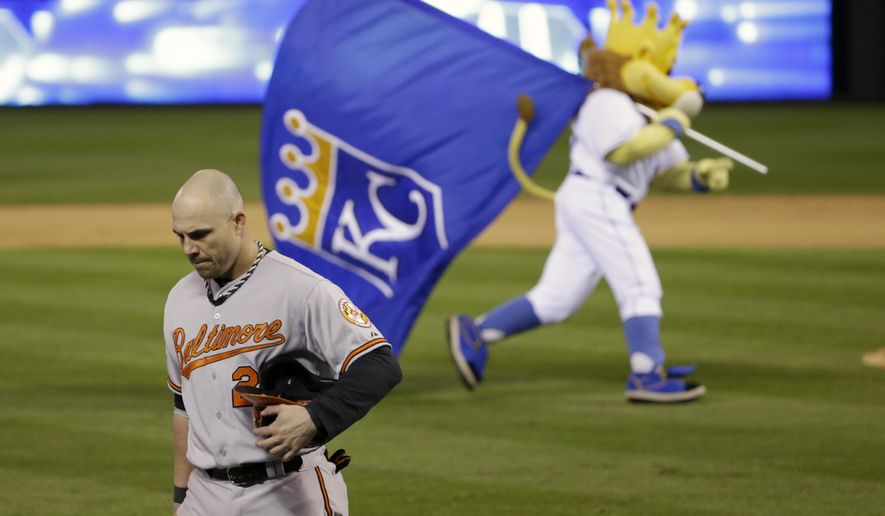Baltimore Orioles' Steve Pearce (28) walks to the dugout after grounding out to second for the final out of Game 3 of the American League baseball championship series against the Kansas City Royals Tuesday, Oct. 14, 2014, in Kansas City, Mo. The Royals won 2-1 and lead the series 3-0. (AP Photo/Matt Slocum )