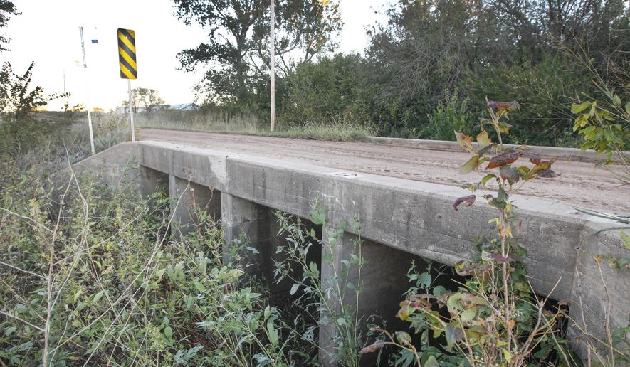 This bridge on 103rd St. South and just east of 311th St. West in southwest Sedgwick County near Wichita, Kan., seen Tuesday, Oct. 14, 2014, is rated as deficient. The bridge will be replaced along, with 77 other deficient bridges, thanks to a special state funding project. (AP Photo/The Wichita Eagle, Fernando Salazar)