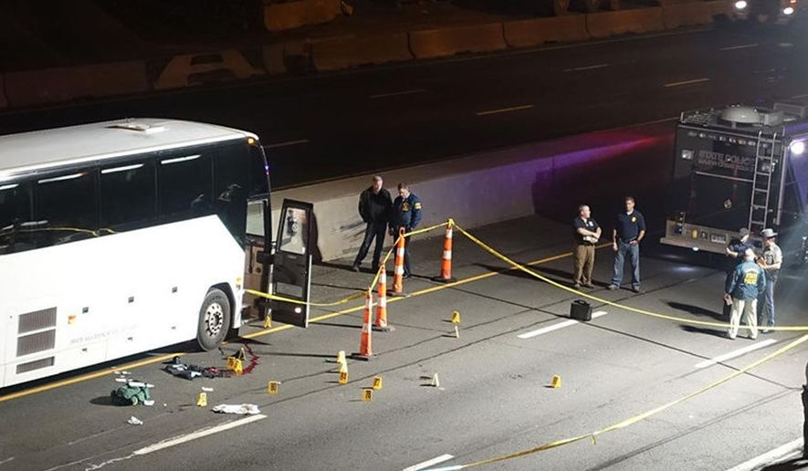 Law enforcement investigate the scene of a stabbing aboard a tour bus late Tuesday, Oct. 14, 2014 in Norwalk, Conn.   A man who stabbed passengers on the casino-bound tour bus on Interstate 95 was fatally shot by state police, officials said Wednesday. The unidentified man began attacking passengers around 10 p.m., state police spokesman Lt. Paul Vance said. The bus driver flagged down a trooper at a construction site. The suspect acted aggressively toward the trooper and was shot when he refused to drop his weapon.  (AP Photo/The Hour, Jeff Dale)