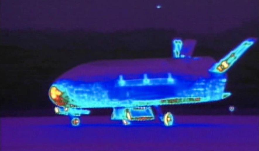 This June 16, 2012 file image from video made available by the Vandenberg Air Force Base shows an infrared view of the X-37B unmanned spacecraft landing at Vandenberg Air Force Base.  The purpose of the U.S. military's space plane is classified, only fueling speculation about why it has been orbiting Earth for nearly two years on this, its third mission. The plane is expected to land this week at a Southern California Air Force base.(AP Photo/Vandenberg Air Force Base, File)