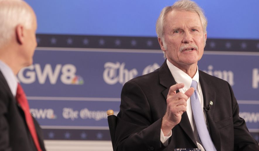 Democratic Gov. John Kitzhaber (right) debates Republican Rep. Dennis Richardson, on Oct. 14, 2014, in a gubernatorial debate held at the KGW studios and co-sponsored by The Oregonian. (AP Photo/The Oregonian, Stephanie Yao Long)