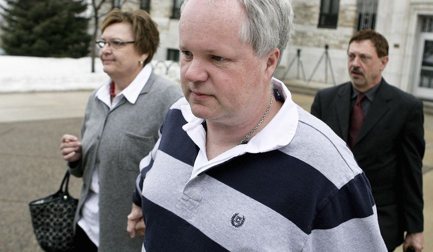 FILD - In this Feb. 17, 2011 file photo William Melchert-Dinkel, center, leaves court with his attorney Terry Watkins, right, and wife, Joyce Melchert-Dinkel in Faribault, Minn. Melchert-Dinkel, a former Minnesota nurse who admitted going online and encouraging an English man and a Canadian woman to kill themselves, was ordered Wednesday, Oct. 15, 2014 to serve 178 days in jail. He was sentenced to nearly five years in prison, but he won't have to serve the prison term if he complies with conditions of probation that include the jail time. (AP Photo/Robb Long, File)