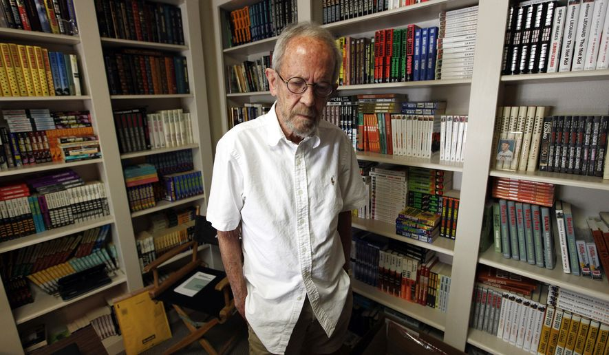 FILE - In this Sept. 17, 2012 file photo, author Elmore Leonard, 86, stands in his Bloomfield Township, Mich., home. Choice samples from a vast collection of handwritten notebooks, typed manuscripts and screenplays by the late best-selling crime novelist Elmore Leonard are going on display at the University of South Carolina. Leonard, a former adman who later in life became one of America's foremost crime writers, has died on Aug. 20, 2013 from complications from a stroke. (AP Photo/Paul Sancya)