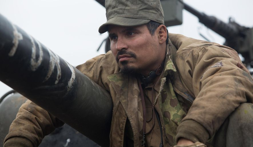 "This photo released by Sony Pictures Entertainment shows Michael Pena, as Trini ""Gordo"" Garcia, in a scene from Columbia Pictures' ""Fury."" (AP Photo/Sony Pictures Entertainment, Giles Keyte)"