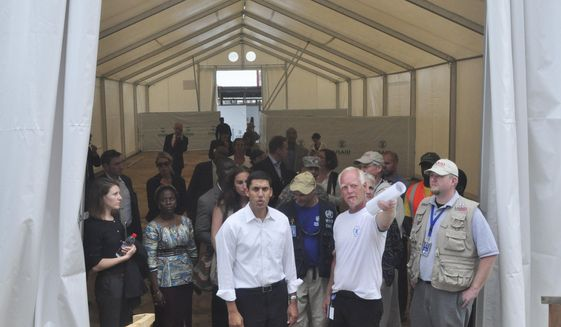 Rajiv Shah (center), serving as administrator of the U.S. Agency for International Development, inspected a newly built treatment center in Monrovia, Liberia, during the devastating 2014 outbreak. A task force organized by the Center for Strategic and International Studies recommended preserving USAID as an independent agency coordinating all U.S. foreign assistance and not folding it into the State Department. (Associated Press/File)