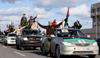 Libyan militias from towns throughout the country's west parade through Tripoli, Libya, Feb. 14, 2012. (Associated Press) ** FILE **