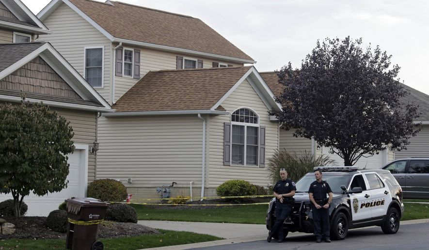 Tallmadge police guard a home in Tallmadge, Ohio Wednesday, Oct. 15, 2014, where Amber Joy Vinson stayed over the weekend before flying home to Dallas. Vinson, a nurse who helped care for Thomas Eric Duncan, has also been diagnosed with the Ebola virus. (AP Photo/Mark Duncan)