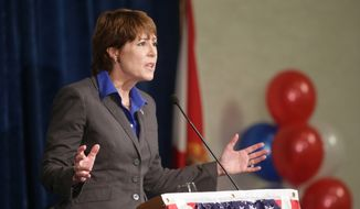 Democratic challenger Gwen Graham responds during a debate with U.S. Rep. Steve Southerland at Florida State University, Wednesday, Oct. 15, 2014, in Tallahassee, Fla. Graham, daughter of popular former Sen. and Gov. Bob Graham, is in a tight race against the two-term Republican for Florida's second Congressional district. (AP Photo/News Herald, Heather Leiphart)