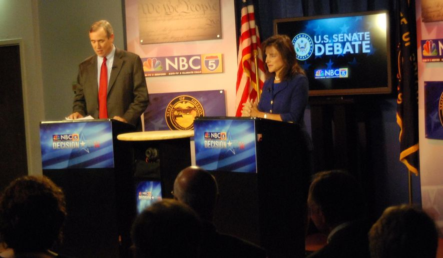 Sen. Jeff Merkley, D-Ore., left, meets Republican challenger Monica Wehby Tuesday, Oct. 14, 2014 at television station KOBI in Medford, Ore., in their only debate of the campaign. The two candidates stuck to famliar themes and Wehby failed to score the kind of breakthrough she needs to overcome Merkley's front-runner status. (AP Photo/Jeff Barnard)