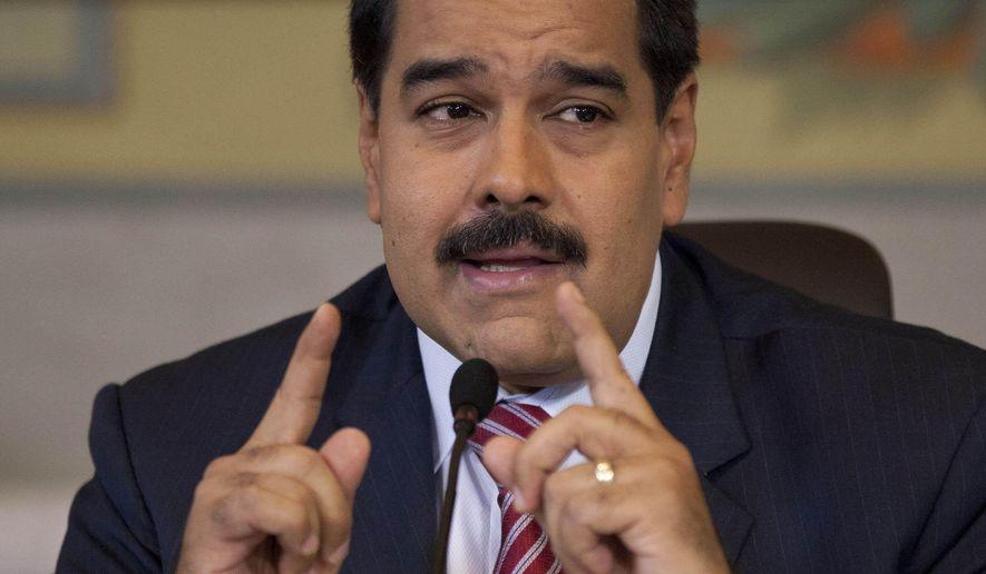 Venezuela's President Nicolas Maduro gives a press conference at Miraflores presidential palace in Caracas, Venezuela, Wednesday, Oct. 15, 2014. (AP Photo/Ariana Cubillos)
