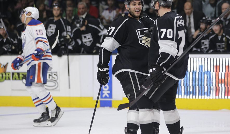 Los Angeles Kings' Tanner Pearson (70) celebrates his goal with Alec Martinez during the second period of an NHL hockey game against the Edmonton Oilers on Tuesday, Oct. 14, 2014, in Los Angeles.(AP Photo/Jae C. Hong)