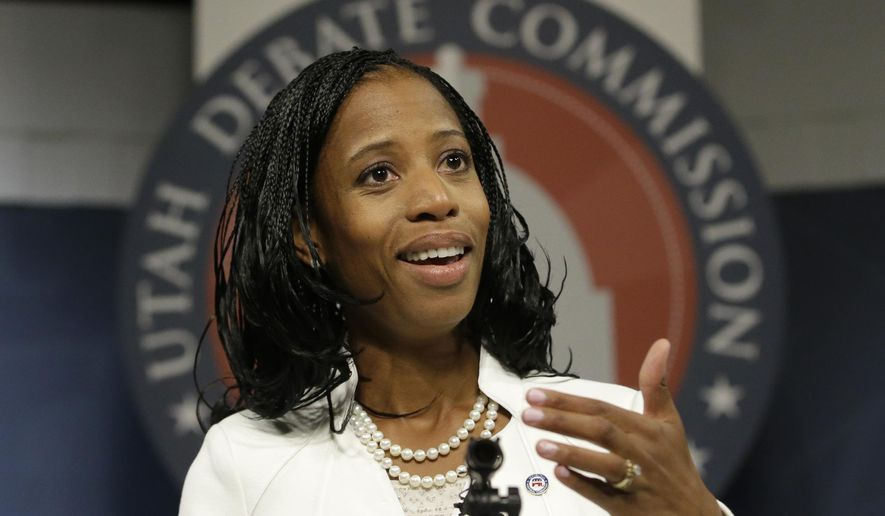 Republican Mia Love speaks to reporters following her debate with Democrat Doug Owens in their race for Utah's 4th Congressional District Tuesday, Oct. 14, 2014, in Salt lake City. The Tuesday night debate is the final one this year from the new Utah Debate Commission. (AP Photo/Rick Bowmer)