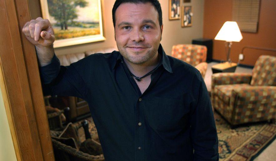 FILE - In a Feb. 11, 2007 file photo, Mars Hill Church Lead Pastor Mark Driscoll poses outside of his office prior to an evening service at the church's flagship black warehouse in Seattle. The Mars Hill website says Seattle megachurch founder Driscoll resigned Tuesday, Oct. 14, 2014, as lead pastor, concluding it would be best for the church, which has branches in five states. (AP Photo/Scott Cohen, File)
