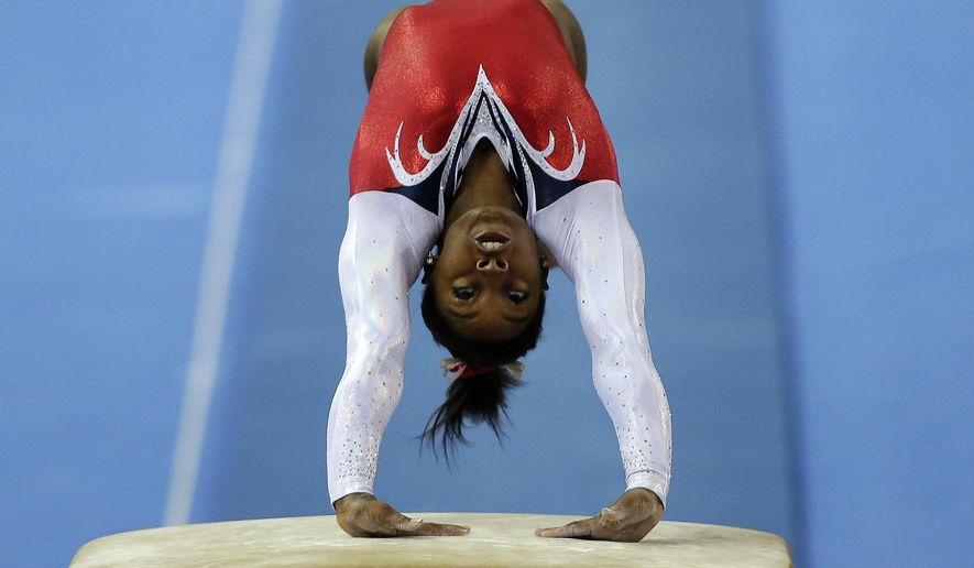 FILE - In this Oct. 11, 2014, file photo, Simone Biles of the United States performs on the vault during the women's vault final of the Artistic Gymnastics World Championship at the Guangxi Gymnasium in Nanning, China. Biles won her second world all-around gymnastics last weekend in China, becoming the first U.S. woman to win two straight world all-around titles since Shannon Miller in 1993-94. (AP Photo/Andy Wong, File)