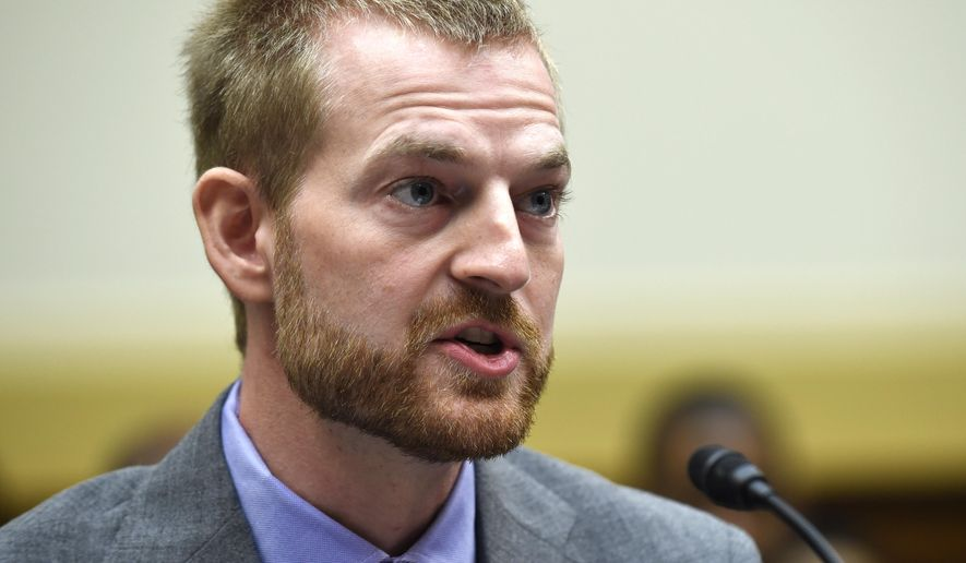 FILE - In a Sept. 17, 2014 file photo, Ebola survivor Dr. Kent Brantly, former Medical Director of Samaritan's Purse Ebola Care Center in Monrovia, Liberia, testifies before the House Foreign Affairs subcommittee on Africa, Global Health, Global Human Rights, and International Organizations during a hearing on Ebola on Capitol Hill in Washington. Brantly went to Texas Health Presbyterian Hospital in Dallas on Sunday, Oct. 12, 2014 to donate the plasma to nurse Nina Pham who is being treated for Ebola. (AP Photo/Susan Walsh, File)