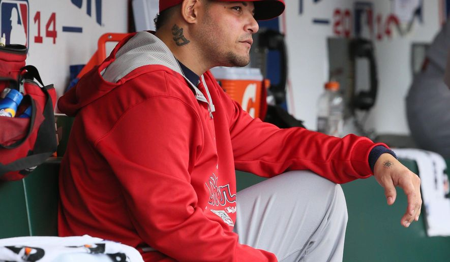 St. Louis Cardinals' Yadier Molina watches from the dugout during the third inning against the San Francisco Giants in Game 3 of baseball's NL Championship Series, Tuesday, Oct. 14, 2014, in San Francisco. The Giants won 5-4 in 10 innings. (AP Photo/St. Louis Post-Dispatch, Chris Lee)