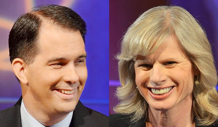 In this combination of Oct. 10, 2014, file photos are Wisconsin Republican Gov. Scott Walker, left, and his Democratic challenger, Mary Burke, at a debate in Eau Claire, Wis. (AP Photo/The Eau Claire Leader-Telegram, Marisa Wojcik, File)