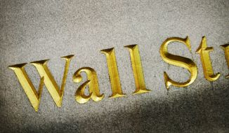 A Wall Street address is carved in the side of a building, Wednesday, Oct. 8, 2014 in New York. European stocks wallowed Wednesday Oct. 15, 2014 on dour growth prospects while Asian shares were mostly higher as a slump in energy prices promised benefits for the region's major economies.  (AP Photo/Mark Lennihan)