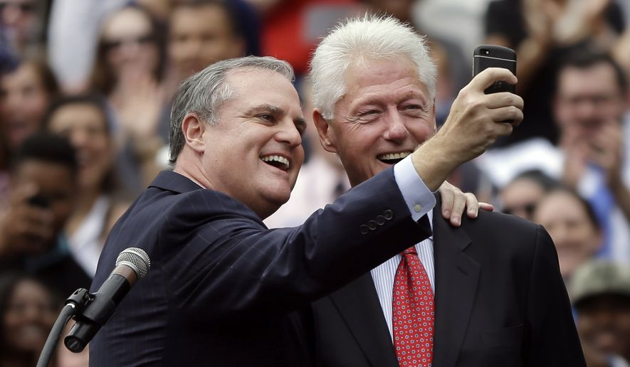 "In this Oct. 6, 2014 file photo, Sen. Mark Pryor, D-Ark., takes a selfie with former President Bill Clinton at a political rally at the University of Central Arkansas in Conway, Ark. Democrats claimed a triumph after former President Bill Clinton recently campaigned in Arkansas, announcing they had signed up enough partisans to fill 4,000 volunteer shifts through Election Day. Now the concern is the ""flake rate"" _ the number who fail to show up. Welcome to the final stages of a costly voter turnout operation in Arkansas and other states, which loom as the Democrats' last line of defense in their effort to keep control of the Senate.  (AP Photo/Danny Johnston)"