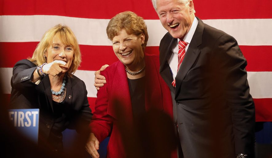 Former President Bill Clinton, right, joined by U.S. Sen. Jeanne Shaheen, D-N.H., center, and Gov. Maggie Hassan arrive to more than 1,000 cheering Democrats at the Democratic Party's annual dinner, Thursday, Oct. 16, 2014 in Manchester, NH (AP Photo/Jim Cole)