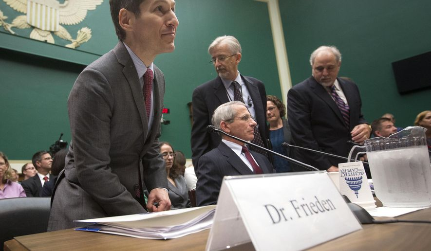 Centers for Disease Control and Prevention (CDC) Director Dr. Tom Frieden, left, takes his seat on Capitol Hill in Washington, Thursday, Oct. 16, 2014, prior to testifying before the House Energy and Commerce Committee's subcommittee on Oversight and Investigations, to get answers about the Ebola outbreak from top U.S. health officials.  (AP Photo/Pablo Martinez Monsivais)