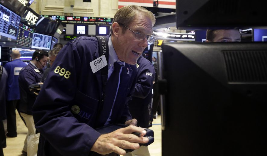 Trader Luke Scanlon works on the floor of the New York Stock Exchange Thursday, Oct. 16, 2014. U.S. stocks are opening lower while European markets suffer even steeper declines. (AP Photo/Richard Drew)
