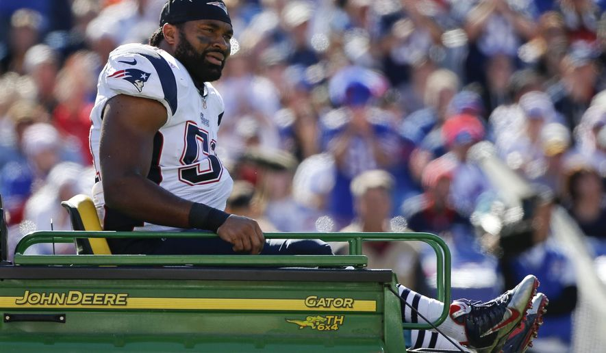 New England Patriots middle linebacker Jerod Mayo (51) is carted off the field after being injured on a play during the first half of an NFL football game against the Buffalo Bills, Sunday, Oct. 12, 2014, in Orchard Park, N.Y. (AP Photo/Mike Groll)