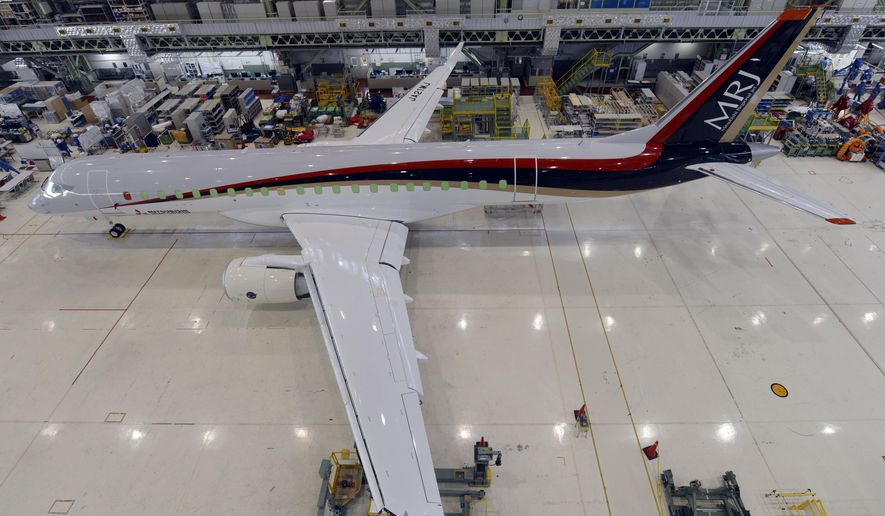 In this June 26, 2014 photo, Mitsubishi's new regional jet MRJ is at the company's Komaki south plant in Komaki, central Japan. The first made in Japan passenger jet in four decades reaches a development milestone later this week. (AP Photo/Mitsubishi Aircraft Corp)