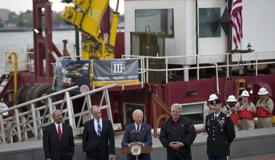 Vice President Joe Biden, center, accompanied by, from left, Rep. Chaka Fattah, D-Pa., Sen. Bob Casey, D-Pa.,, Rep. Bob Brady, D-Pa., and U.S. Army Corps of Engineers  Lt. Colonel Michael Bliss, speaks after a tour of a dredging barge, Thursday, Oct. 16, 2014, at Penn's Landing along the Delaware River in Philadelphia.  Biden discussed the importance of investing in the nation's infrastructure during his visit to the waterfront. (AP Photo/Matt Rourke)