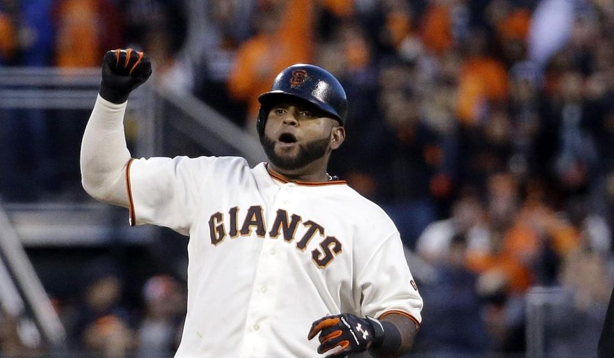 San Francisco Giants' Pablo Sandoval celebrates a double against the St. Louis Cardinals during the fourth inning of Game 5 of the National League baseball championship series Thursday, Oct. 16, 2014, in San Francisco. (AP Photo/Jeff Roberson)