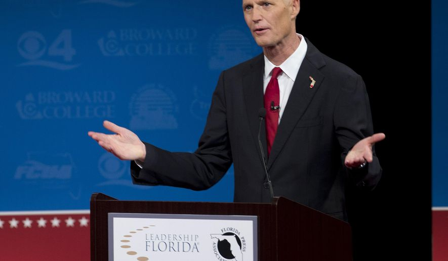 Florida Republican Gov. Rick Scott speaks during a debate with Democratic challenger Charlie Crist, Wednesday, Oct. 15, 2014 in Davie, Fla. It is sponsored by the Florida Press Association and Leadership Florida. (AP Photo/J Pat Carter)