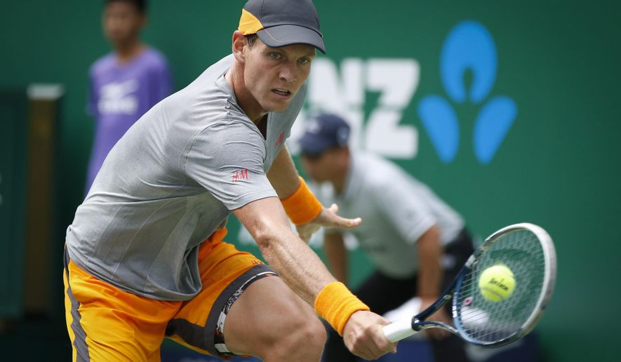 Tomas Berdych of the Czech Republic returns a shot against Gilles Simon of France during their men's singles quarterfinal match at the Shanghai Masters tennis tournament in Shanghai, China, Friday, Oct. 10, 2014.  (AP Photo/Vincent Thian)