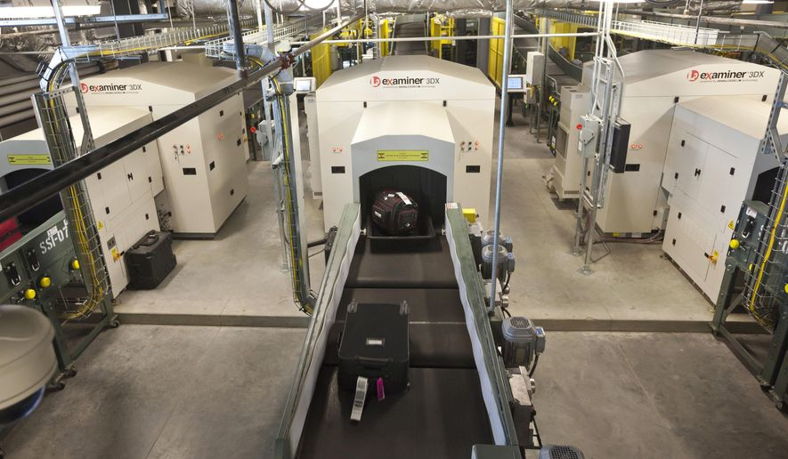 FILE - In this Oct. 16, 2012 file photo, air travelers' bags ride a conveyor into one of three new advanced in-line screening machines at Bill and Hillary Clinton National Airport in Little Rock, Ark. Arkansas' largest airport wants to spend nearly $300,000 to prevent power interruptions from causing its baggage-handling system to shut down, according to ArkansasOnline. (AP Photo/Danny Johnston, file)