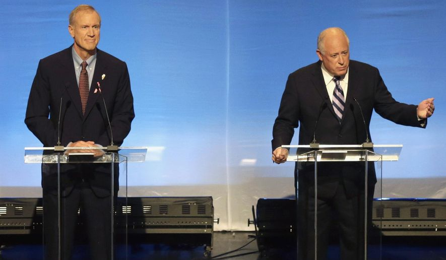 FILE - In this Oct. 14, 2014 file photo, Illinois gubernatorial candidates Republican Bruce Rauner, left, and incumbent Democrat Gov. Pat Quinn participate in a debate in Chicago. There is a $1 billion disagreement between the two on whether spending on public education in Illinois has increased or decreased under Quinn. Rauner alleges that Quinn decreased school aid nearly $600 million since taking office in 2009. Quinn says he's increased it by more than $400 million. (AP Photo/Charles Rex Arbogast, File)