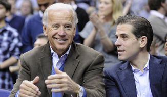 Former Vice President Joseph R. Biden is left standing in the crosshairs in the Democratic presidential race with the revelation that his son Hunter made hundreds of thousands of dollars through his employment with Burisma, the largest private gas company in Ukraine. (Associated Press/File)