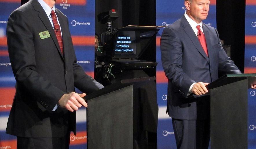 Democratic challenger Pete Gosar, left, stands next to Wyoming Gov. Matt Mead, a Republican seeking re-election, before a debate Thursday, Oct. 16, 2014, in Riverton, Wyo. Libertarian candidate Dee Cozzens and independent Don Wills also participated. (AP Photo/Ben Neary)