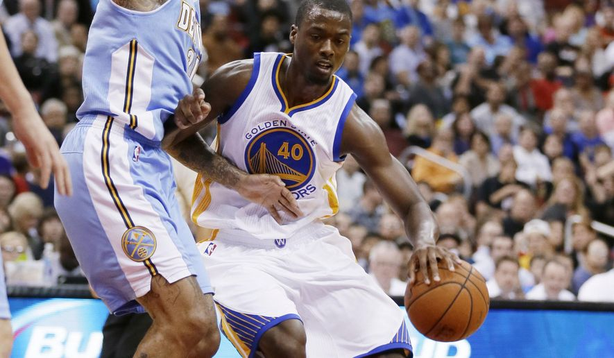 Golden State Warriors forward Harrison Barnes, right, drives to the basket past Denver Nuggets forward Wilson Chandler during the first half of a preseason NBA basketball game, Thursday, Oct. 16, 2014, in Des Moines, Iowa. (AP Photo/Charlie Neibergall)