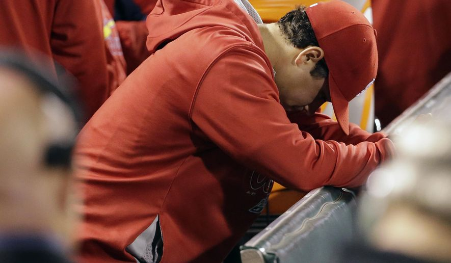 St. Louis Cardinals pitcher Marco Gonzales hangs his head after being taken out of the game against the San Francisco Giants during the sixth inning of Game 4 of the National League baseball championship series Wednesday, Oct. 15, 2014, in San Francisco. (AP Photo/David J. Phillip)
