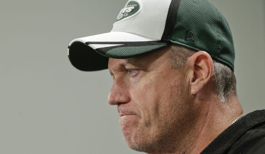 ADVANCE FOR WEEKEND EDITIONS, OCT. 18-19 - FILE - In this May 16, 2014, file photo, New York Jets head coach Rex Ryan answers questions during a news conference at the team's NFL football rookie camp in Florham Park, N.J. (AP Photo/Julie Jacobson, File)
