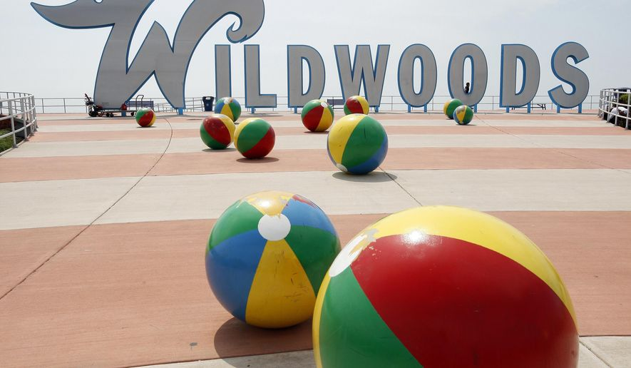 FILE - This May 27, 2010 file photo shows the famous Wildwoods sign and decorative concrete beachballs on the boardwalk in Wildwood, N.J.  The 17-foot-tall welcome sign is getting a makeover, having suffered salt corrosion since its installation in 2008. (AP Photo/Mel Evans, File)