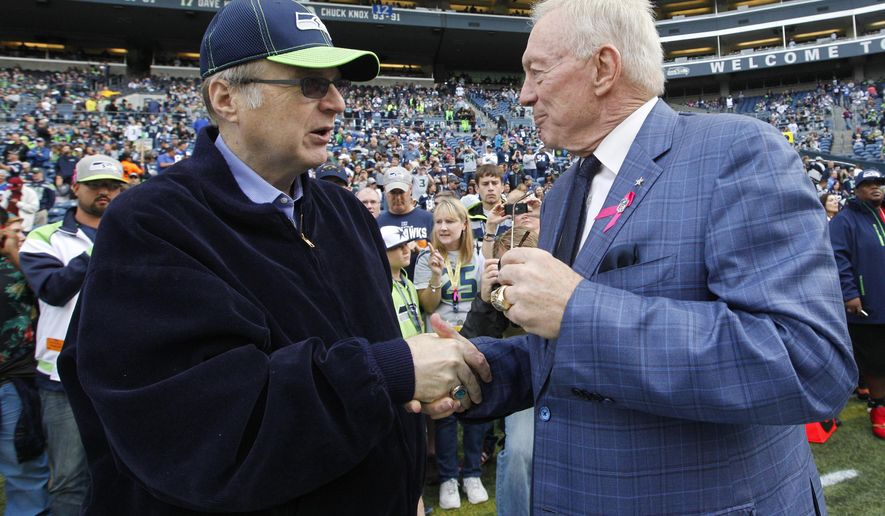 Seattle Seahawks owner Paul Allen, left, talks with Dallas Cowboys owner and general manager Jerry Jones, right, before an NFL football game, Sunday, Oct. 12, 2014, in Seattle. (AP Photo/Elaine Thompson)