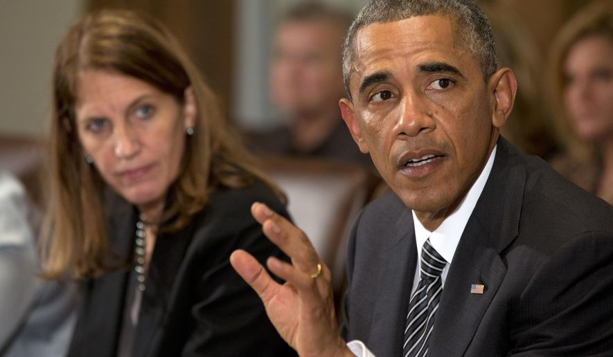 President Barack Obama, right, next to Health and Human Services Secretary Sylvia Burwell, speaks to the media about Ebola during a meeting in the Cabinet Room of the White House in Washington, Wednesday, Oct. 15, 2014, with members of his team coordinating the government's response to the Ebola outbreak. (AP Photo/Jacquelyn Martin)